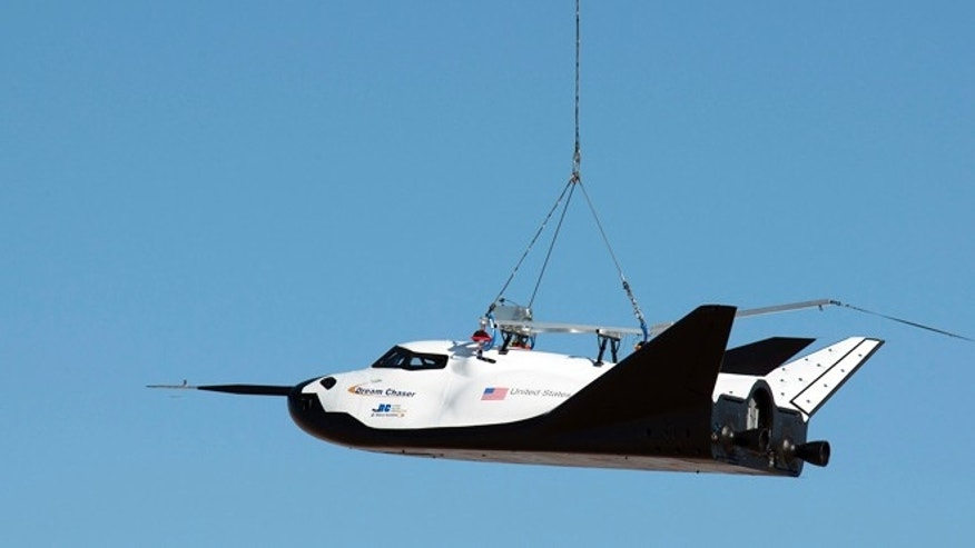 Aug. 22, 2013: A Sikorsky S-64 Sky Crane helicopter lifts Sierra Nevada Corp.'s Dream Chaser test spacecraft into the air for a captive carry test at NASA's Dryden Flight Research Center.