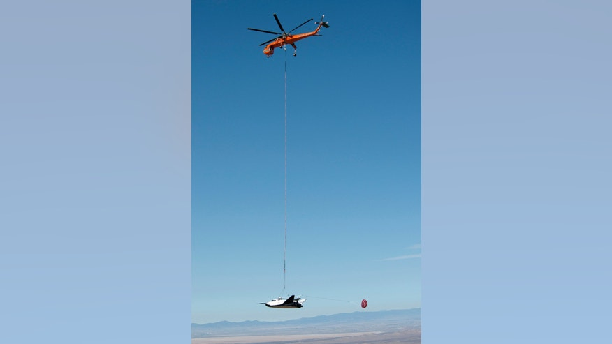 Aug. 22, 2012: A Sikorsky S-64 Sky Crane helicopter operated by Erickson Air Crane lifts Sierra Nevada's Dream Chaser test spacecraft into the air for a captive carry test at NASA's Dryden Flight Research Center.