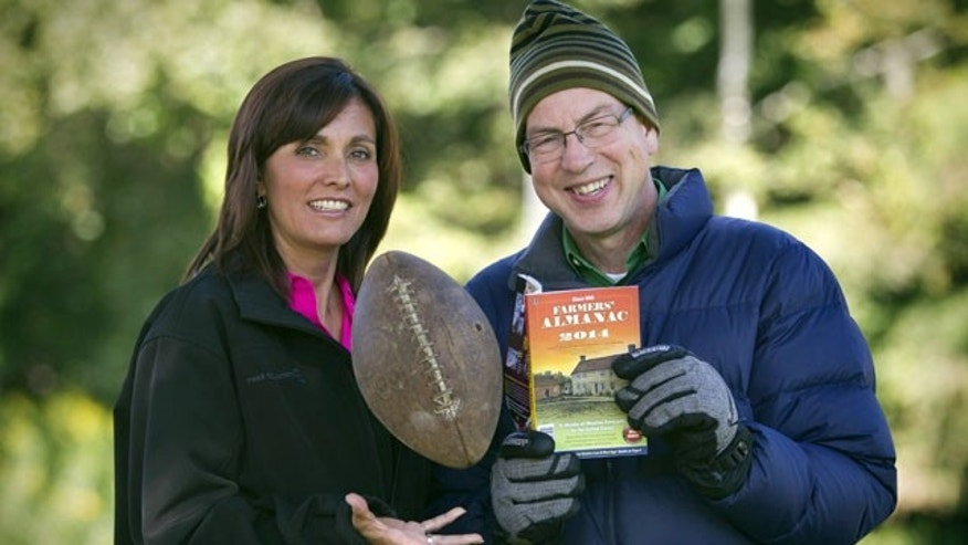 August 23, 2013: Farmers' Almanac managing editor Sandy Duncan, left, and editor Peter Geiger, pose in Lewiston, Maine. The 197-year-old almanac is predicting a colder-than-normal winter for most of the United States, with a winter storm hitting around the time of the Super Bowl on Feb. 2, 2014, in New Jersey. (AP Photo)