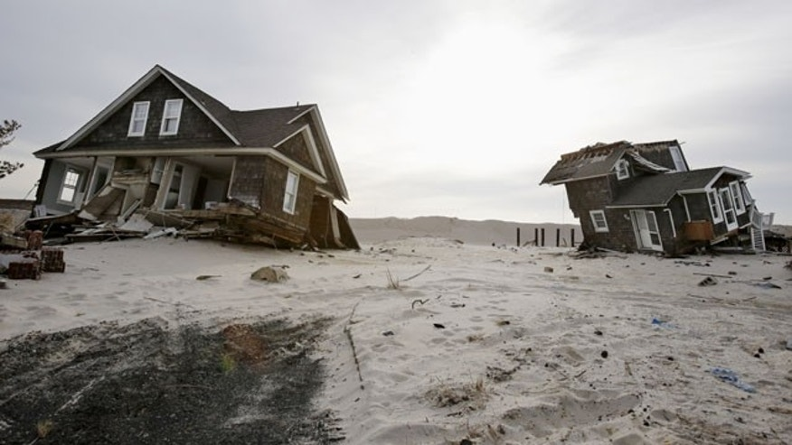 FILE - This Feb. 22,2013 file photo shows Two heavily damaged homes on the beach in Mantoloking, N.J., from Superstorm Sandy. (AP Photo)