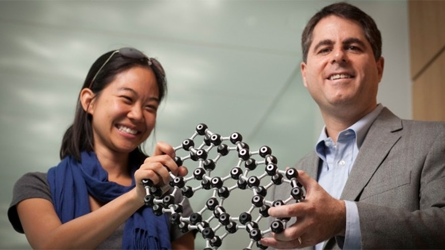 Cornell University graduate student Pinshane Huang and Professor David Muller with a model that depicts the atomic structure of glass. They were the first to directly image the world's thinnest sheet of glass.
