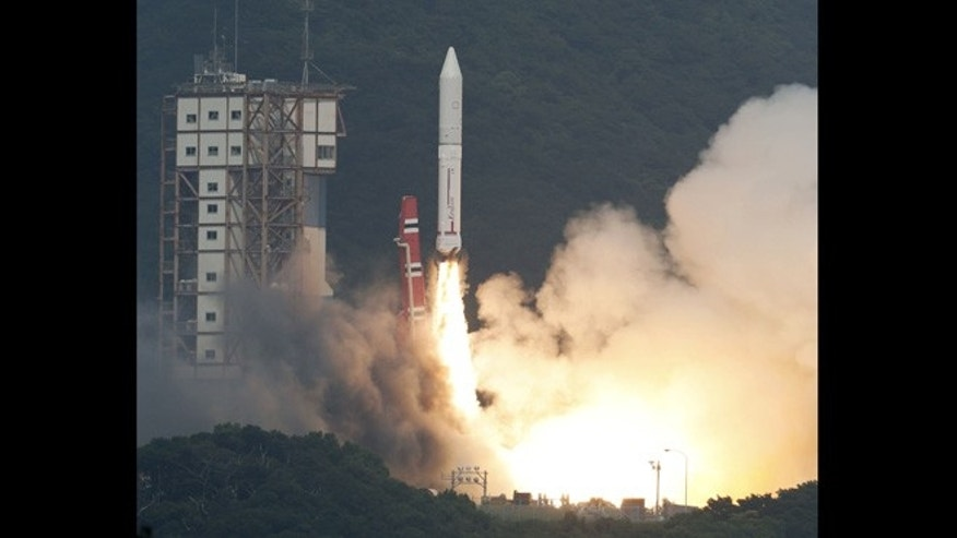 Sept. 14 2013: An Epsilon rocket lifts off from the Uchinoura Space Center in Kimotsuki town, Kagoshima, western Japan. Japan launched the new rocket it hopes will be a cheaper and more efficient way of sending satellites into space, following a two-week postponement.