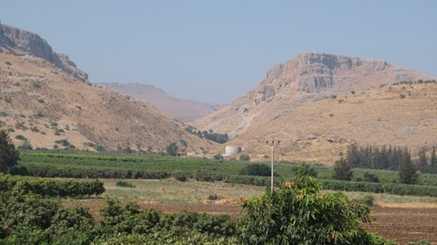 View looking southwest showing the mountains bounding the Ginosar Valley in Israel. Archaeologists found pottery remains, cubes known as tesserae and, in the modern town, architectural fragments indicating a town flourished in the area from the second or first century B.C. until after the fifth century A.D.