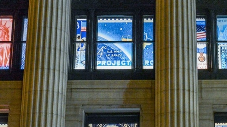 "Enlarged reproductions of the ""20th Anniversary Moon Landing"" and ""Project Mercury"" stamps adorn the windows of the William H. Gross Stamp Gallery at the National Postal Museum."