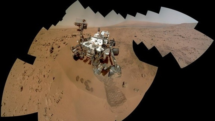 SA's Mars rover Curiosity is a mosaic of photos taken by the rover's Mars Hand Lends Imager taken on Sol 85, the rover's 85th Martian day, as Curiosity was sampling rocks at a stop dubbed Rocknest in Gale Crater. Image released Sept. 26, 2013.