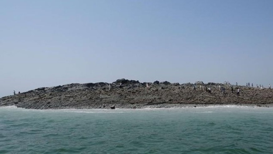 Sept. 25, 2013: An island that rose from the sea following an earthquake is pictured off Pakistan's Gwadar coastline in the Arabian Sea .