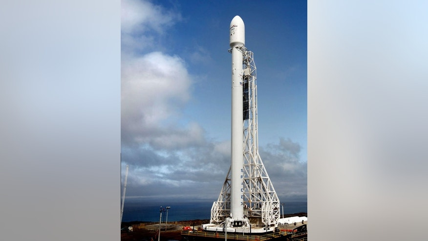 An upgraded SpaceX Falcon 9 rocket stands poised to launch from Space Launch Complex 4 at Vandenberg Air Force Base in California in September 2013. Liftoff set for Sept. 29, 2013.