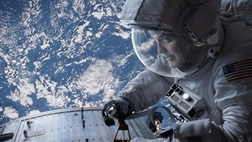 "George Clooney as Matt Kowalski in Warner Bros. Pictures' thriller ""Gravity."""