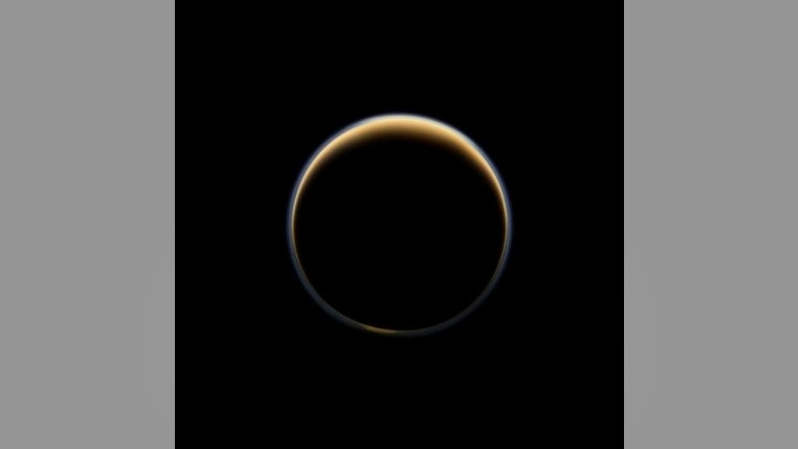 Saturn's moon Titan's atmosphere creates a ring of light outlining the large moon. Image uploaded on Sept. 30, 2013.