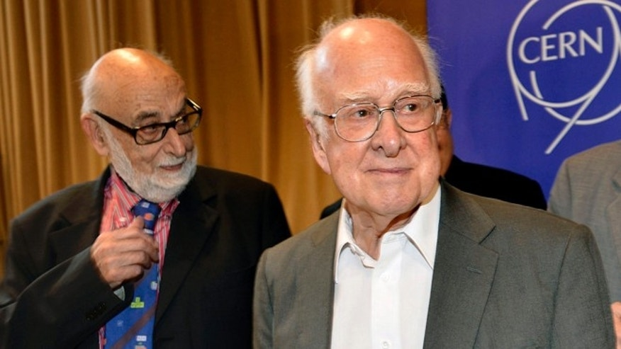 July 4, 2012: Belgian physicist Francois Englert, left, and British physicist Peter Higgs leave after they answer journalist's questions at the European Organization for Nuclear Research (CERN) in Meyrin near Geneva, Switzerland. Englert and Higgs were awarded the 2013 Nobel Prize in physics on Tuesday Oct. 8, 2013.