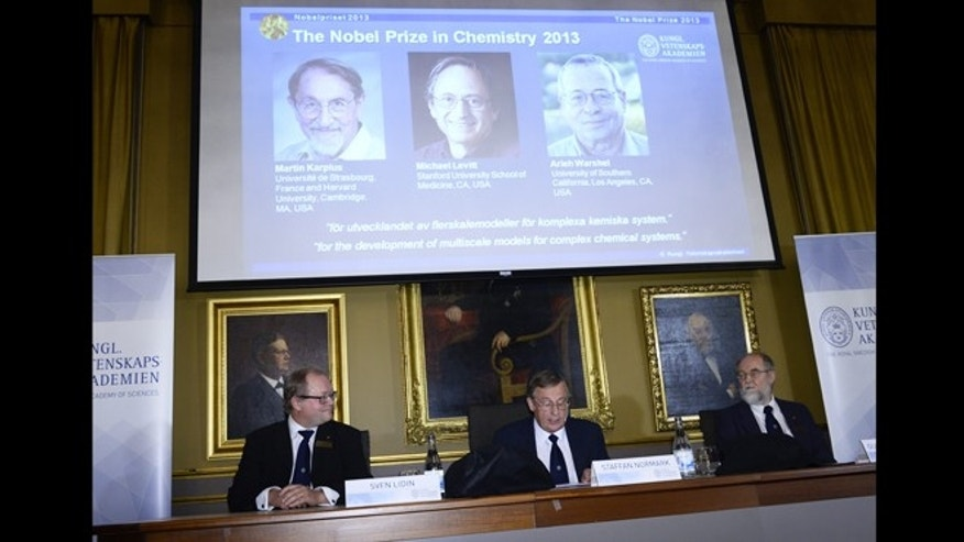 Oct. 9, 2013: Chairman Sven Lidin, left, permanent secretary Staffan Normark, center, and professor Gunnar Karlstrom of the Royal Swedish Academy of Sciences announce the laureates Martin Karplus, Michael Levitt and Arieh Warshe as winners of the 2013 Nobel Prize in chemistry, during a press conference at the Royal Swedish Academy of Sciences in Stockholm, Sweden.
