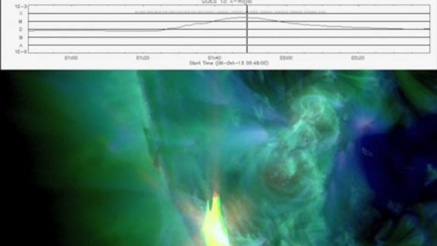 An M2.8 class flare erupted from Sunspot AR1865 at 9:48 p.m. EDT (0148 GMT on Oct. 9) in this still image taken from a video by NASA's Solar Dynamics Observatory.