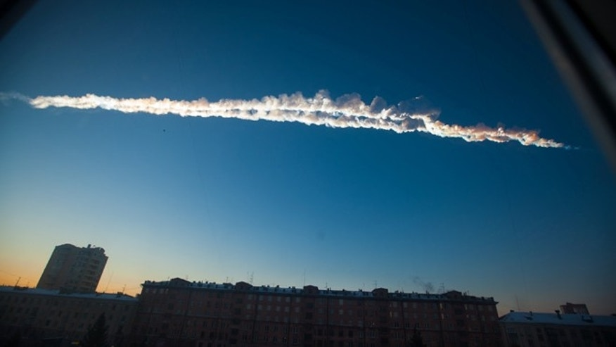 Feb. 15, 2013: A meteorite contrail is seen over the Ural Mountains' city of Chelyabinsk, about 930 miles east of Moscow, Russia.