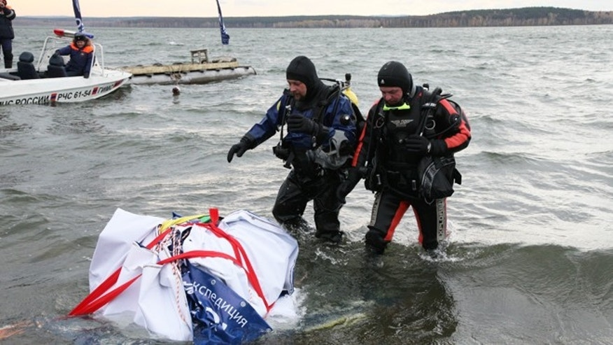 Oct. 16, 2013: Divers retrieve what is believed to be part of the Chelyabinsk meteor from Chebarkul Lake near Chelyabinsk, some 930 miles east of Moscow.