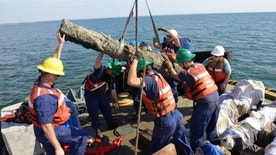 Oct. 28, 2013: The crew of the Coast Guard Cutter Smilax and personnel from the North Carolina Department of Cultural Resources worked to recover five cannons and multiple barrel hoops from the Queen Anne's Revenge in Beaufort Inlet, N.C.