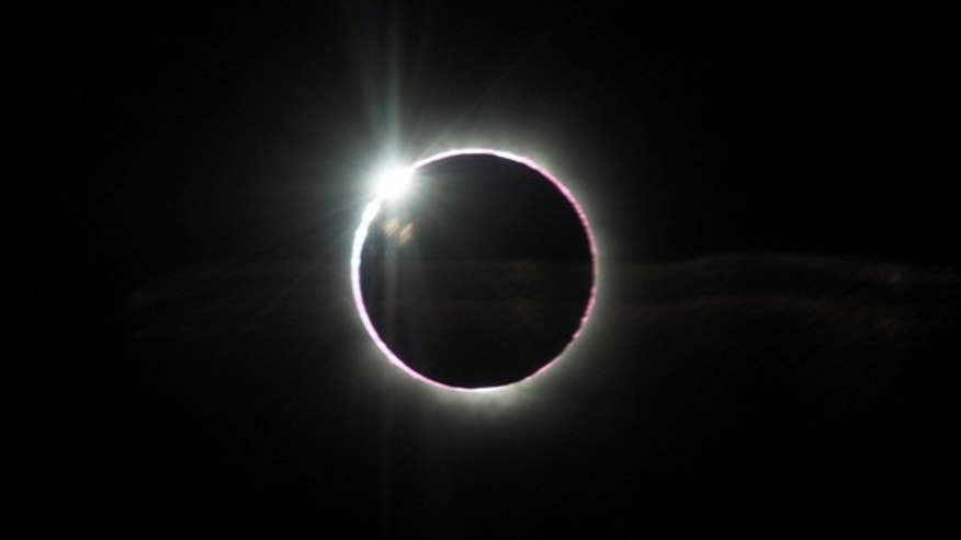 The diamond ring effect of the 2013 total solar eclipse is seen in this amazing photo by eclipse-chasing photographer Ben Cooper, who captured the image from an airplane at 43,000 feet on Nov. 3, 2013 during a rare hybrid annual/total solar ecl