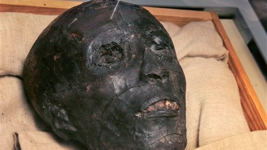 The face of the linen-wrapped mummy of King Tut is seen in his glass case in his underground tomb in the famed Valley of the Kings in Luxor, Egypt.