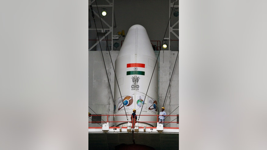 Oct. 30, 2013: Indian technicians inspect the Polar Satellite Launch Vehicle (PSLV – C25) at the Satish Dhawan Space Center at Sriharikota.
