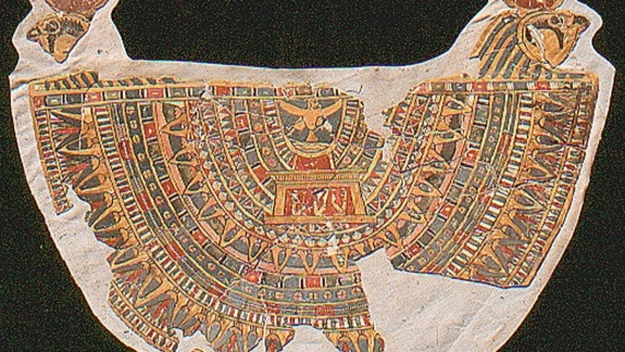 "This 2,300-year-old collar, which was worn by a mummy, was discovered in fragments in a tomb in Thebes. The falcons in the top corners signify the god Horus, while the ""Ba-bird"" at top center represents the immortal soul of the deceased mummy."