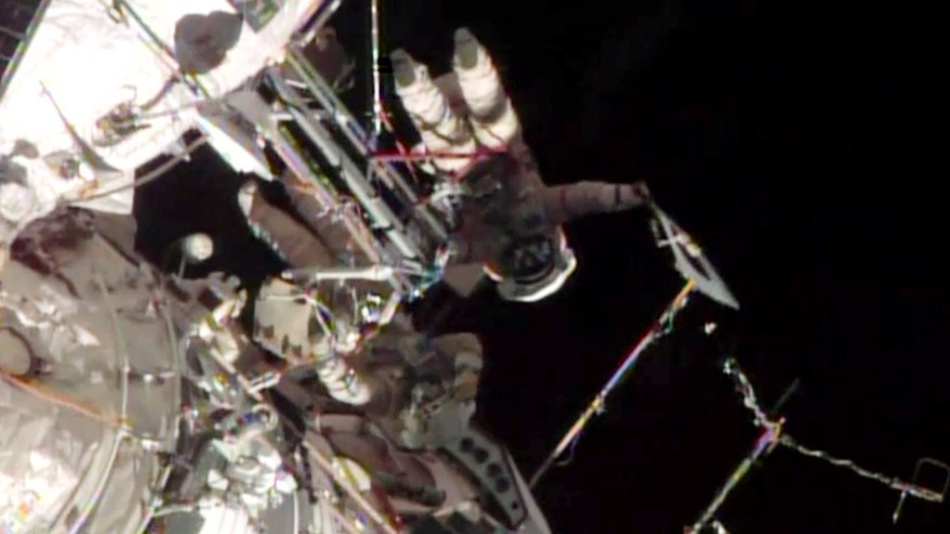 Nov. 9, 2013: This screen image taken from NASA shows the Sochi Olympic torch being held during a spacewalk.