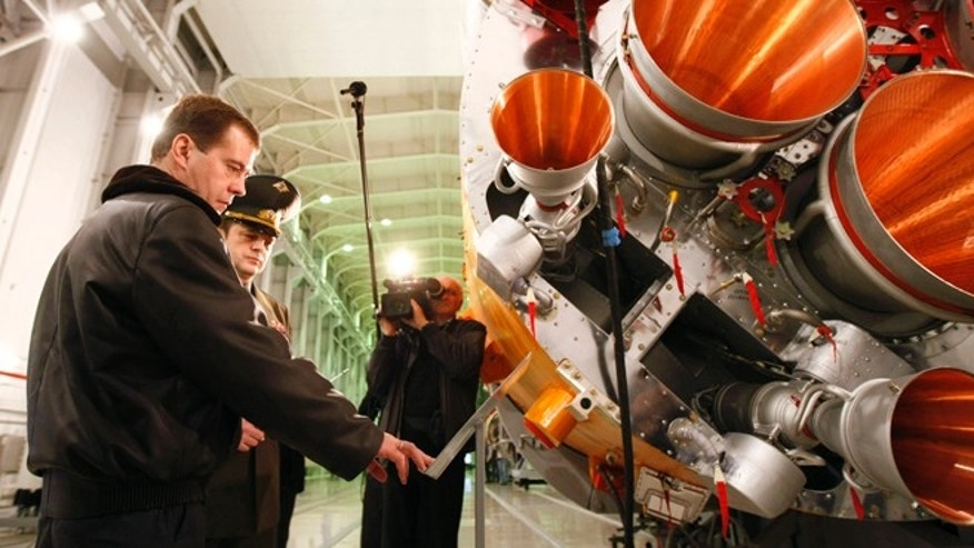 Russian Prime Minister Dmitry Medvedev (L) visits Plesetsk cosmodrome in northern Russia, October 11, 2008.