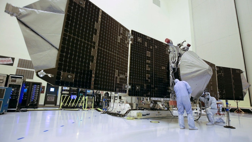 Sept. 27, 2013: In this file photo, technicians work on NASAs next Mars-bound spacecraft, the Mars Atmosphere and Volatile Evolution (MAVEN), at the Kennedy Space Center in Cape Canaveral, Fla.