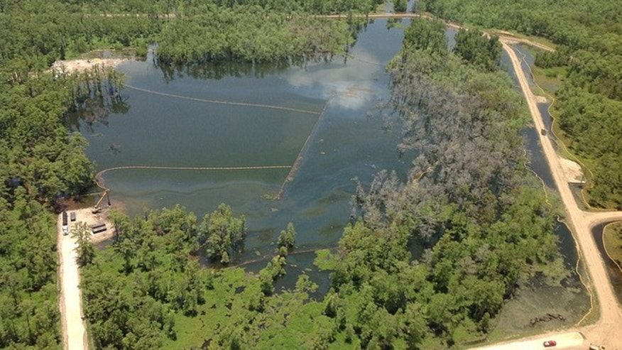 The Bayou Corne sinkhole in southern Louisiana is now reportedly 25 or so acres in size and 200 feet deep, having opened in August 2012 when the wall of a subterranean salt mine collapsed and the ground above it was seemingly swallowed by the earth. It has since filled with water.
