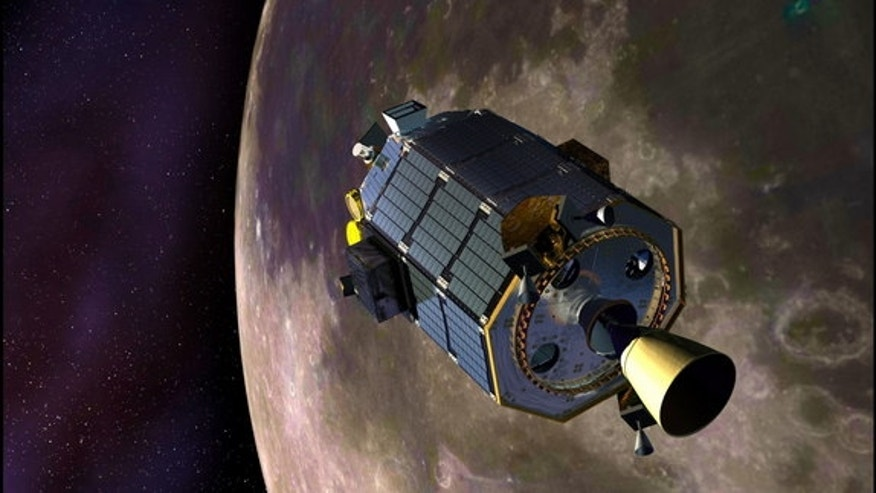 An artist's concept of NASA's Lunar Atmosphere and Dust Environment Explorer (LADEE) spacecraft orbiting the moon and preparing to fire its maneuvering thrusters to maintain a safe orbital altitude. Image released August 15, 2013.