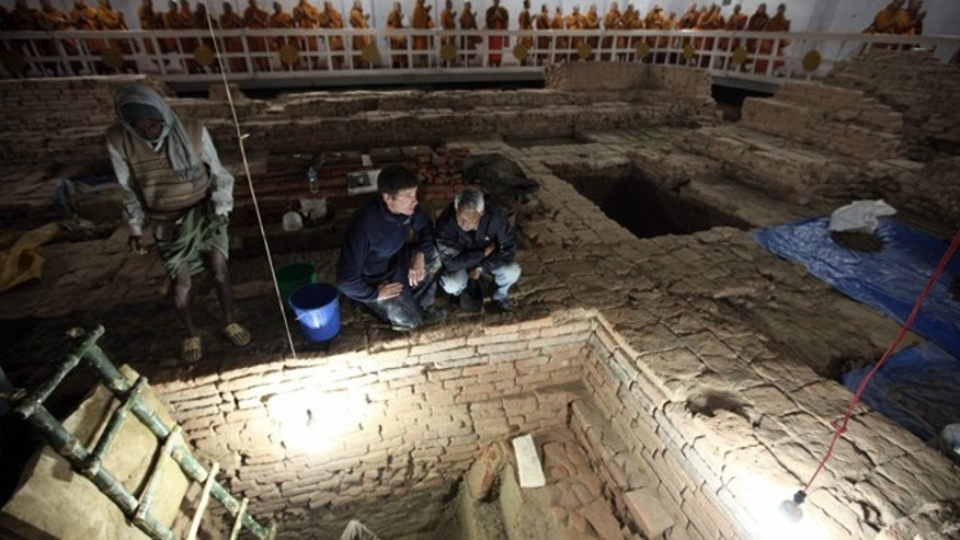 Archaeologists Robin Coningham (left) and Kosh Prasad Acharya direct excavations within the Maya Devi Temple, uncovering a series of ancient temples contemporary with the Buddha. Thai monks meditate.