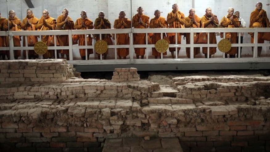 Thai monks inside the Maya Devi Temple meditate over the remains of the oldest Buddhist shrine in the world at Lumbini, Nepal.
