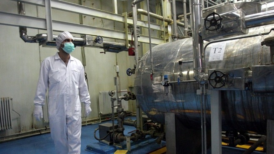An Iranian technician walks through a Uranium Conversion Facility just outside the city of Isfahan 255 milessouth of the capital Tehran in 2007.