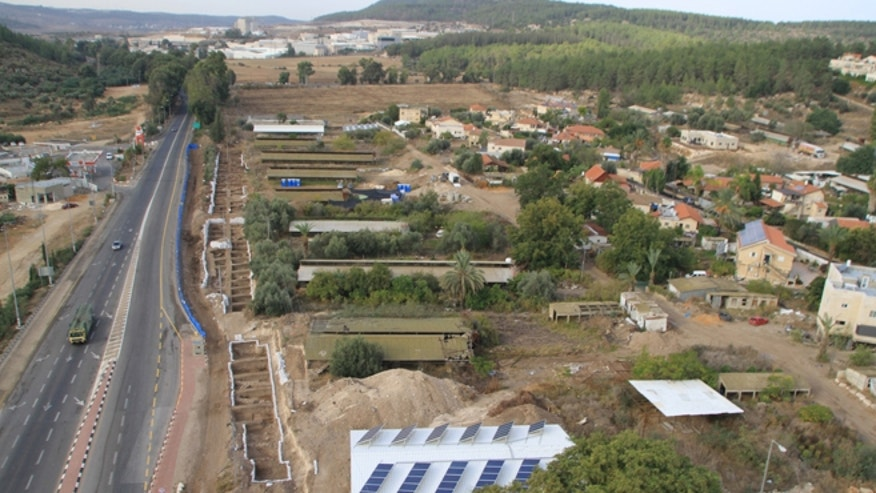 An aerial view of the large excavation along Highway 38.