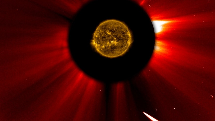 Nov. 28, 2013: In a composite image provided by NASA, Comet ISON nears the sun in an image captured at 10:51 a.m. Eastern Standard Time.