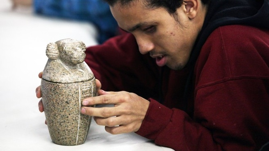 Nov. 25, 2013: Angel Ayala  touches a replica of a vessel during the classroom segment of a special tour at the Penn Museum in Philadelphia. Ayala, 16, has been blind since birth.