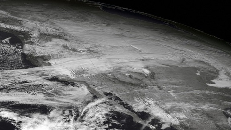 The GOES West satellite snapped this image of a major winter storm affecting the West and Northern Plains on Dec. 3, 2013. The storm dumped snow and sent temperatures diving well below normal.