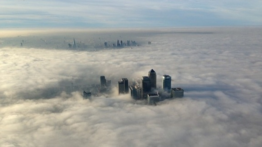 A thick fog blankets London's Canary Wharf business district on Dec. 10, 2013.