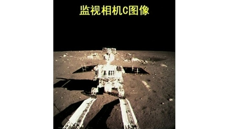 "December 15, 2013: This image taken from video, shows China's first moon rover touching the lunar surface and leaving deep traces on its loose soil, several hours after the country successfully carried out the world's first soft landing of a space probe on the moon in nearly four decades. The writing at the top of the image reads ""Surveillance camera C image."" (AP Photo/CCTV VNR via AP video)"