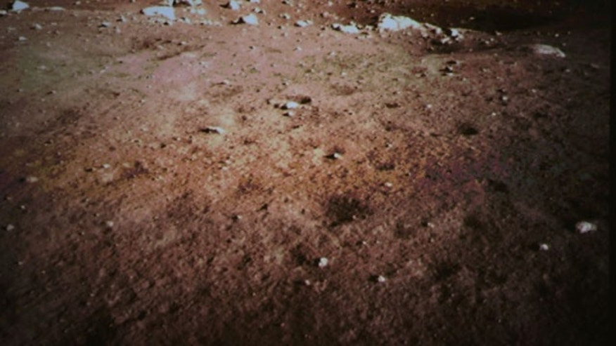 December 14, 2013: This photo released by China's Xinhua News Agency, shows a picture of the moon surface taken by the on-board camera of the lunar probe Chang'e-3 on the screen of the Beijing Aerospace Control Center in Beijing, capital of China. (AP)