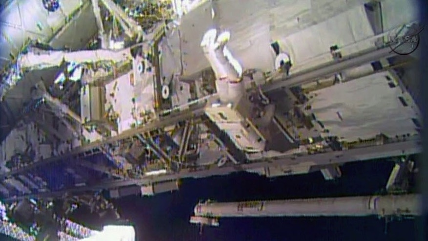 Dec. 21 2013: In this image made from video provided by NASA, astronaut Rick Mastracchio performs a space walk outside the International Space Station.