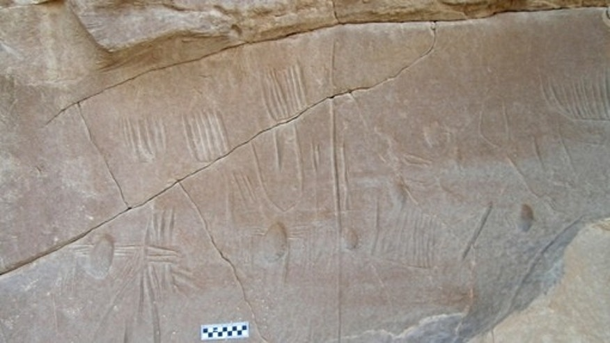Archaeologists have discovered a broken panel that depicts the only known example of spider rock art in Egypt and, it appears, the entire Old World.