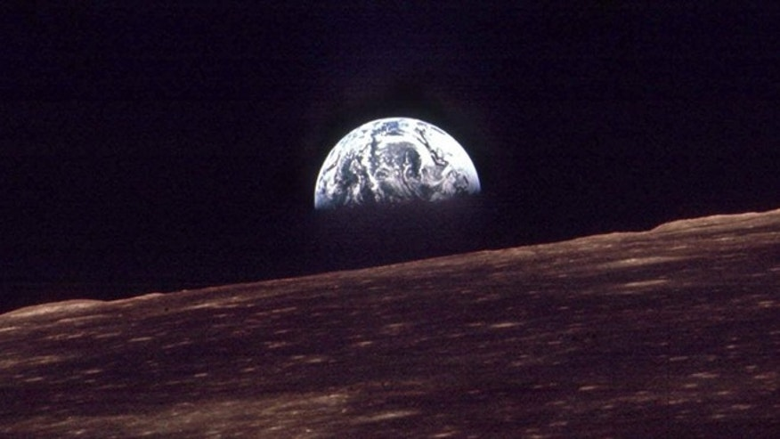 In this Dec. 24, 1968 photo, the Earth shines over the horizon of the Moon in as seen by the astronauts on Apollo 8. Apollo 8 was launched from Cape Canaveral on Dec. 21, 1968.
