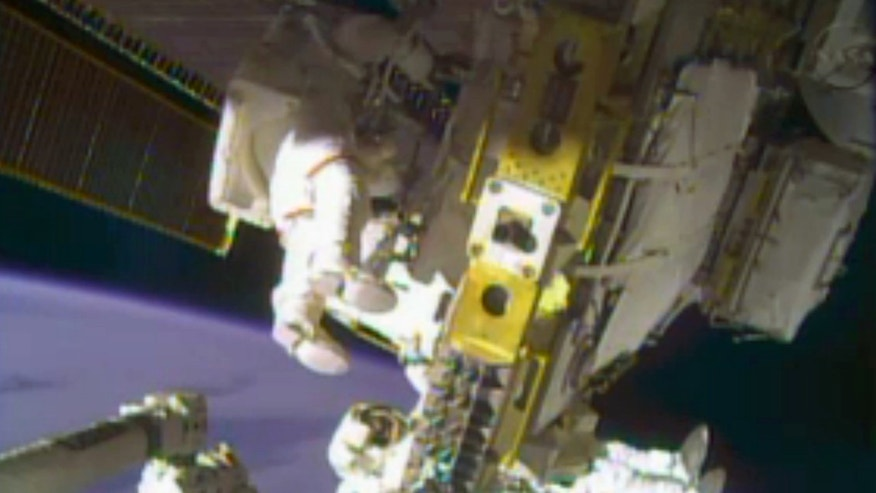 Dec. 24, 2013: In this image taken from video provided by NASA, astronauts Rick Mastracchio, top, and Michael Hopkins work to repair an external cooling line on the International Space Station 260 miles above Earth.