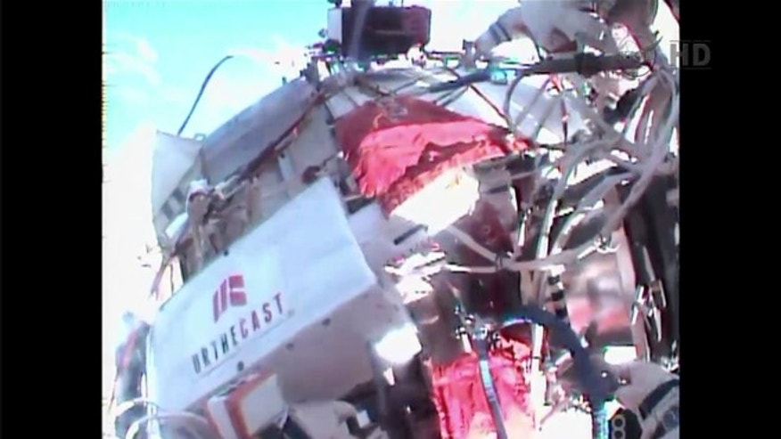 Dec. 27, 2013: A screenshot taken during a Russian spacewalk shows the UrtheCast camera, which will eventually beam a live video of the Earth from the International Space Station.