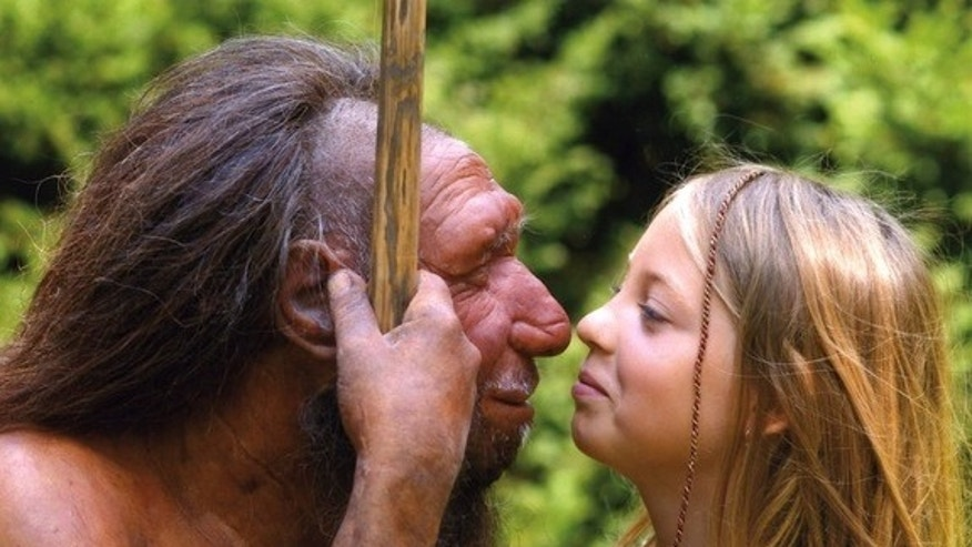 A girl goes nose-to-nose with a Neanderthal statue in Germany. Ancient DNA research is increasingly revealing the genetic links between modern humans and our extinct ancestors, including Neanderthals and the mysterious Denisovans.
