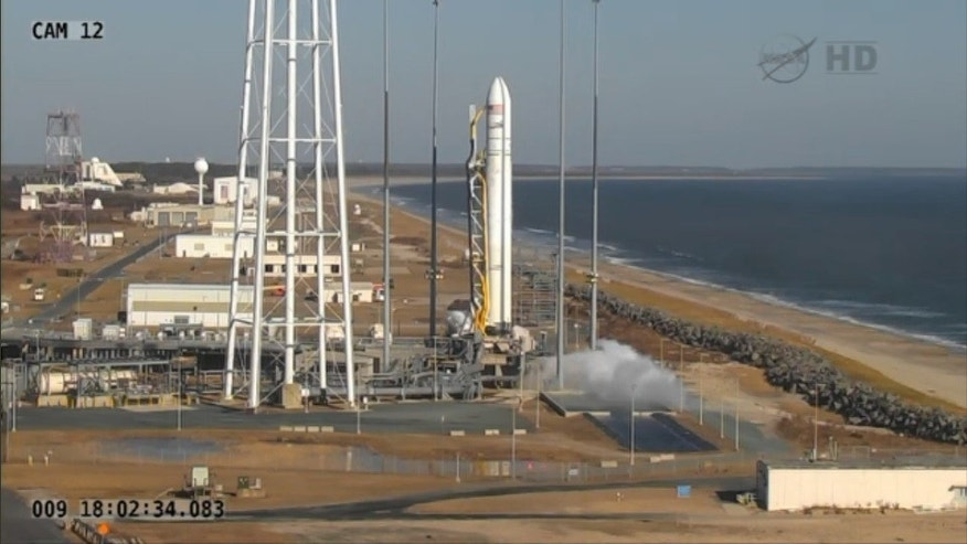 Jan. 9, 2014: An Orbital Sciences Corporation Antares rocket sits on the launch pad at NASA's Wallops Flight Facility in Wallops Island, Va. minutes before launch.