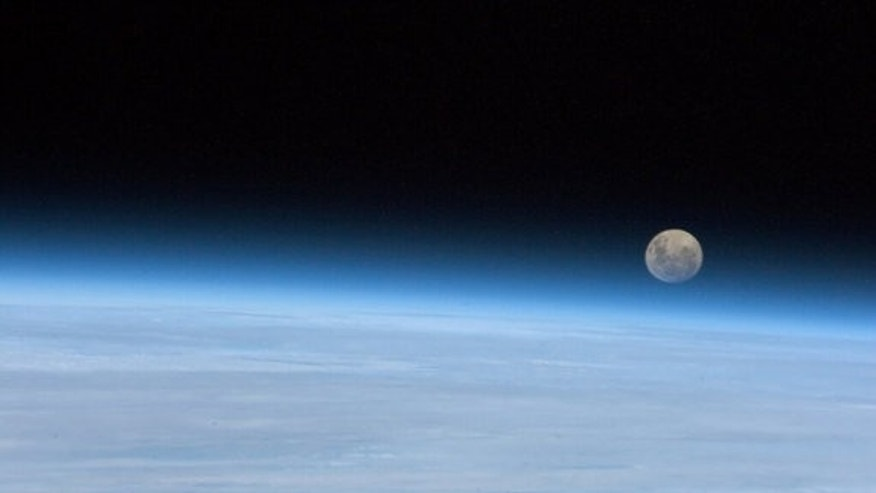 "Astronaut Chris Hadfield snapped this photo of a full moon on Jan. 30, 2013, from the International Space Station. ""Full Moon rising. So near, and yet..."" he wrote."