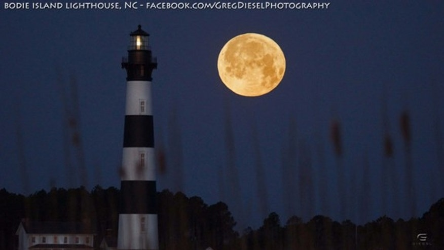 "Astrophotographer Greg Diesel Walck sent in a photo of the full moon setting by the Bodie Island Lighthouse, Outer Banks, NC, taken March 27, 2013. He writes: ""I have been trying to get a shot like this for almost a year.  The weather and timin"