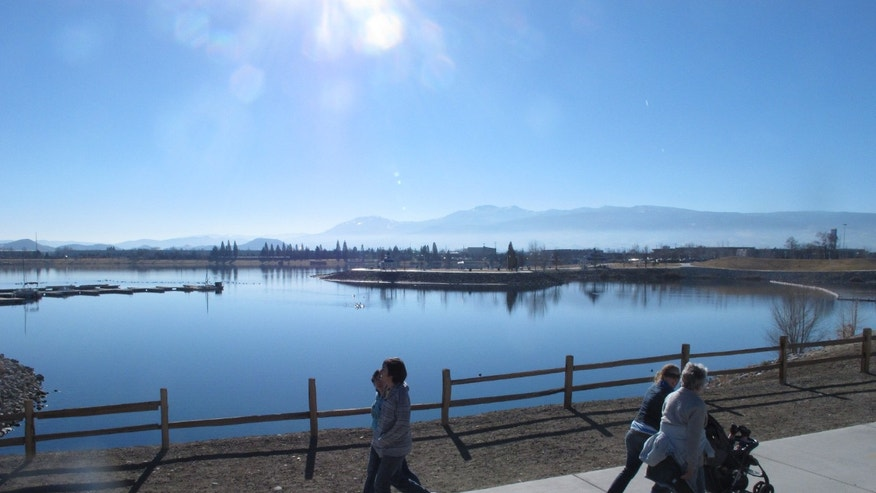 Jan. 15, 2014: Joggers and dog-walkers make their way around the Sparks Marina, where state wildlife biologists are trying to figure out what caused the kill-off the man-made lake's entire stocked fishery -- an estimated 100,000 trout, bass and catfish.