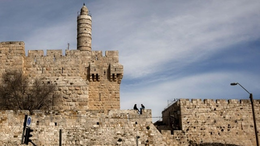 FILE - This March 7, 2012 file photo shows the Tower of David in Jerusalem's old city. Archaeologists say they've uncovered the remains of Herod's Palace, where many Biblical scholars believe Jesus was tried by Pontius Pilate. (AP Photo/Sebastian Scheiner, File)