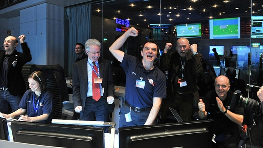 Jan. 20, 2014: Scientists with the European Space Agency rejoice upon hearing from the Rosetta spacecraft, which has slumbered in deep space for 31 months.